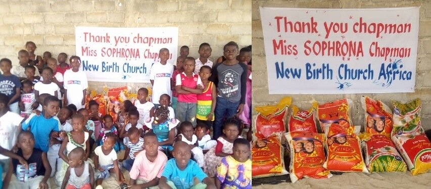 African Orphans posing in front of sign thanking Sophrona Chapman