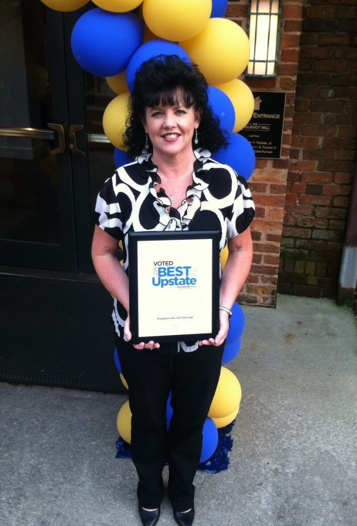 Tina Stephens holding Powdersville Self Storage's Best of The Upstate award